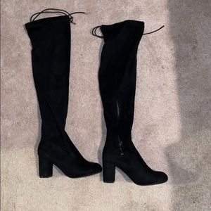 Never worn, black mid thigh high boots with heel.